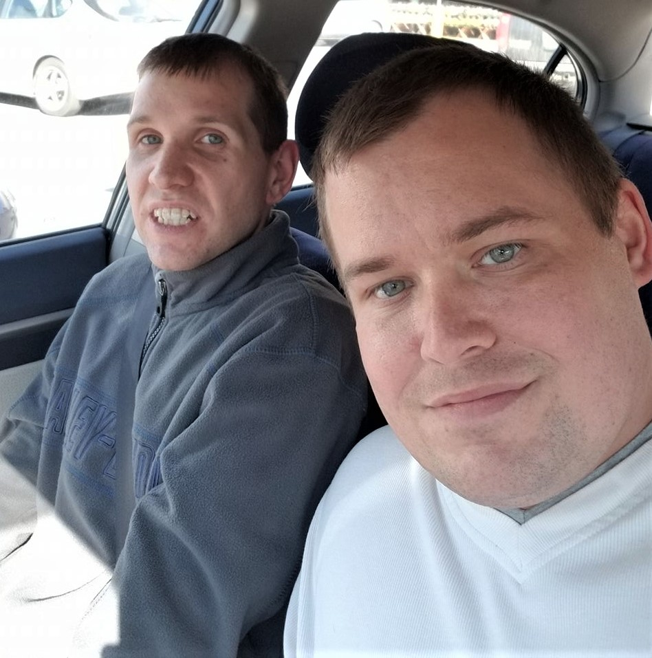 photo of Kyle and Kevin sitting in the front seat of a car