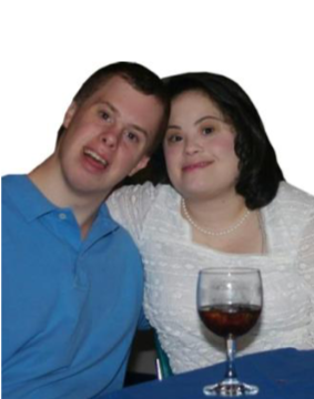 Couple smiling together with a glass of wine