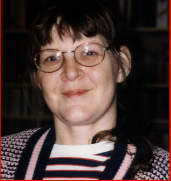 A close-up of a woman, Susan, smiling for the camera