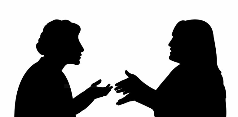 28247708 - black silhouettes of two women, talking to each other