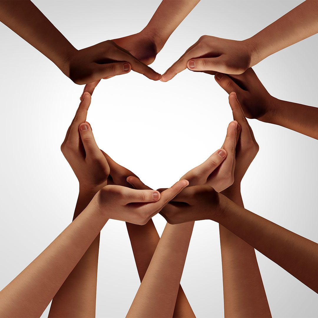 Diverse group of hands forming a heart